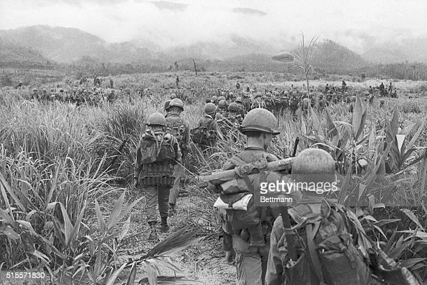 Troopers of the 327th Infantry of the US 101st Air Cavalry Division treked through shoulderhigh grass while patroling an area near the Laotian border...
