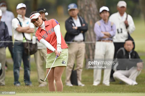 Saiki Fujita of Japan chips onto the 8th green during the first round of the World Ladies Championship Salonpas Cup at the Ibaraki Golf Club on May 7...
