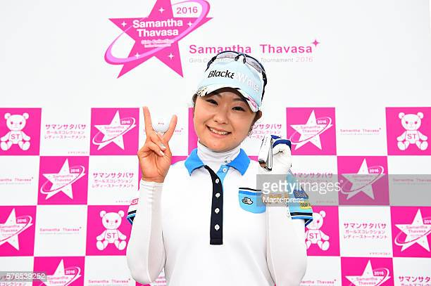 Saiki Fujita of Japan poses with her ball and club after making a holeinone on the 5th hole during the second round of the Samantha Thavasa Girls...