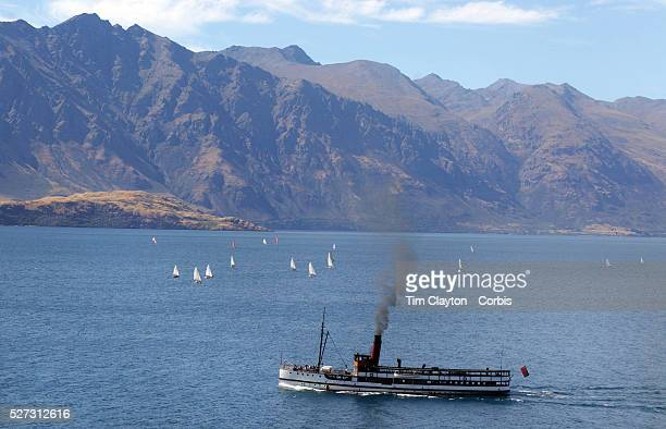 Sail and Steam Yacht's sail from Queenstown to Kingston in competition on Lake Wakatipu with the Remarkables Mountain Range providing a stunning...