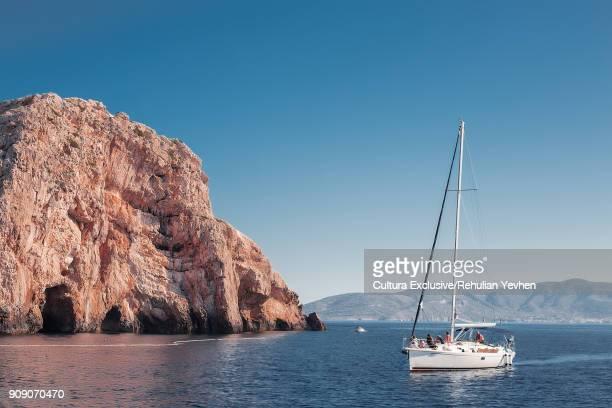 Sail boat by rock formation in sea, Koralat, Zagrebacka, Croatia