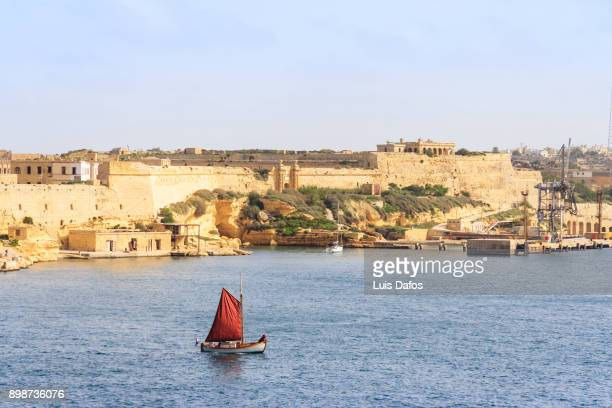 sail boat in grand harbour - dafos stock photos and pictures