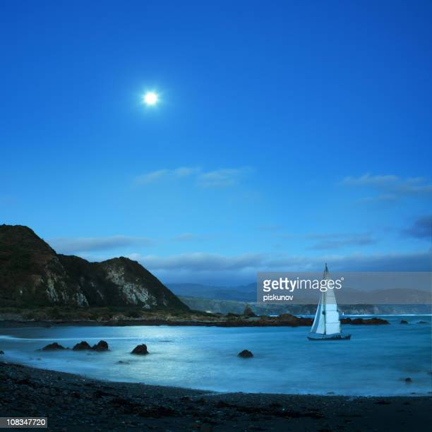 Sail boat in night bay
