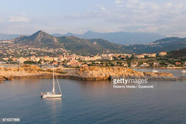 Sail boat in the clear sea Ile Rousse Corsica