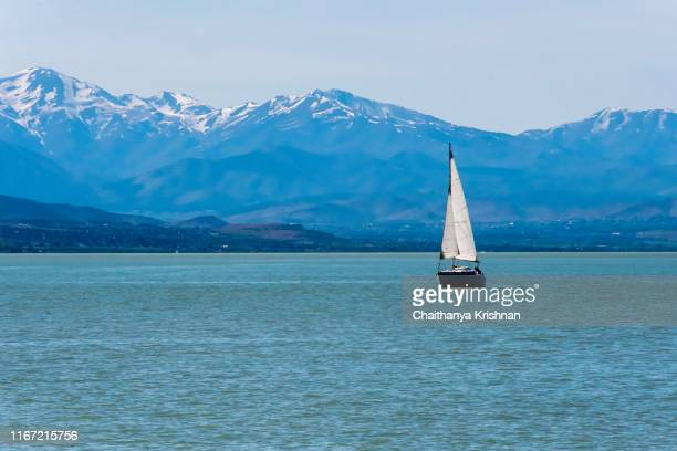 a sail boat in the utah lake within provo town of ut - provo stock pictures, royalty-free photos & images
