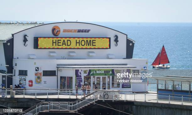 A sail boat passes the pier on May 29 2020 in Bournemouth United Kingdom The British government continues to ease the coronavirus lockdown by...