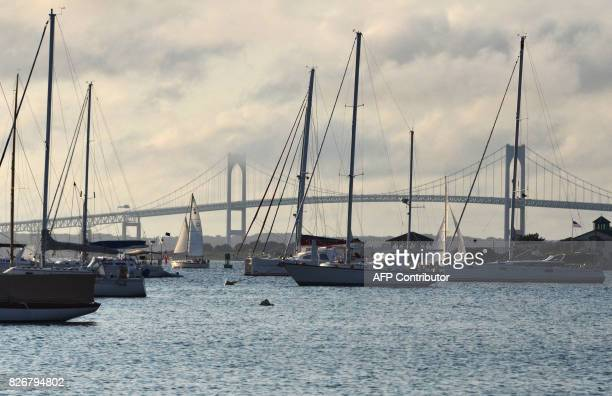 Sail boats are seen in Brenton Cove August 5 2017 in Newport Rhode Island / AFP PHOTO / EVA HAMBACH