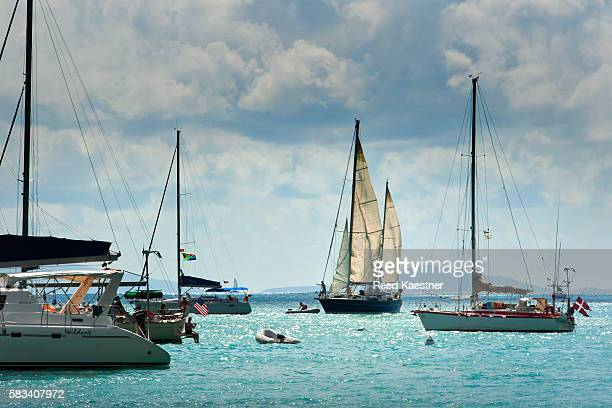 Sail boats race off the island off Saint Barthélemy in the Leeward Islands