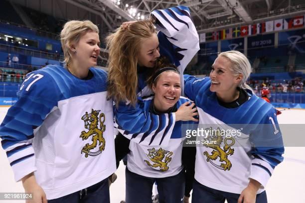 Saila Saari Eveliina Suonpaa Minnamari Tuominen and Annina Rajahuhta of Finland celebrate after defeating Olympic Athletes from Russia 32 during the...