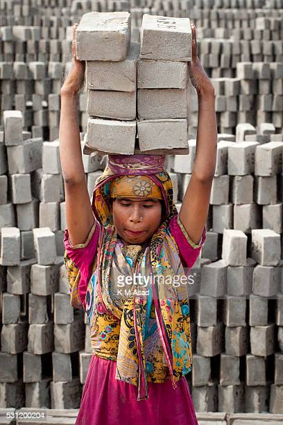 Saila works in a brickfield covered with thick dust in Dhaka Bangladesh January 18 2016 In this brickfield burning coal causes tremendous production...