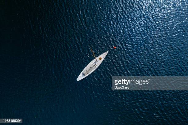 sailboat anchored up - sailing stock pictures, royalty-free photos & images