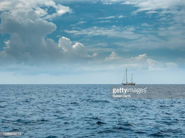 Sailboat and a cloud