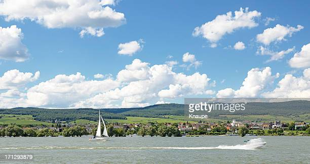 Sailboat and motorboat on river rhine