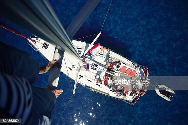 Sailboat and ship crew seen from top of the mast