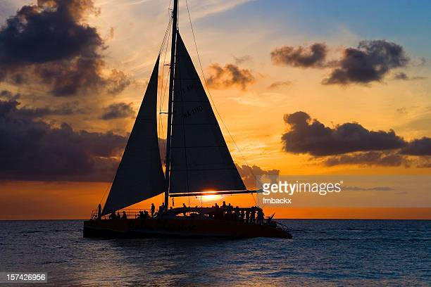 sailboat and sunset - catamaran stock photos and pictures