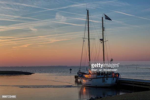 A sailboat and winter morning light