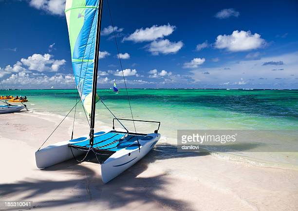 sailboat at caribbean sea - catamaran stock photos and pictures