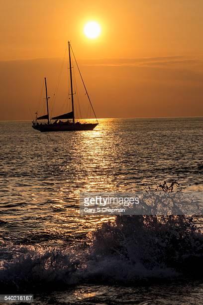 Sailboat at sunset, Hawaii