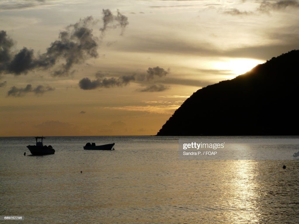 A sailboat at sunset in Martinique : Stock Photo