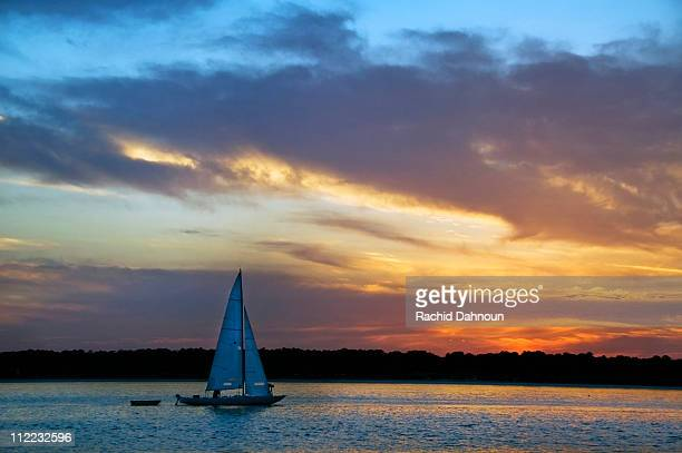a sailboat at sunset on hilton head island, south carolina. - hilton head stock pictures, royalty-free photos & images