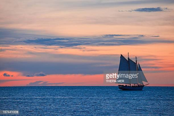 sailboat at sunset - key west stock photos and pictures