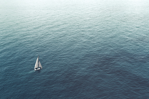 sailboat challenge the sea, aerial view 978274000