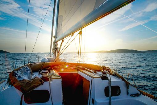 Sailboat Crossing at Dusk 1015332748
