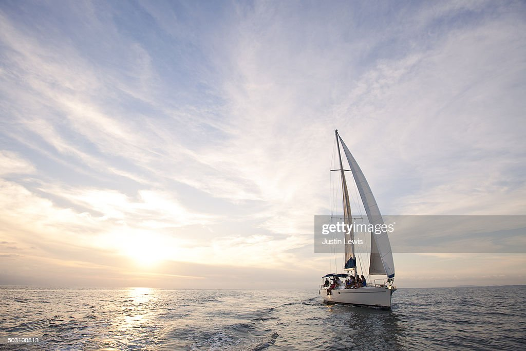 Sailboat cruise during gorgeous sunset at sea : Stock Photo