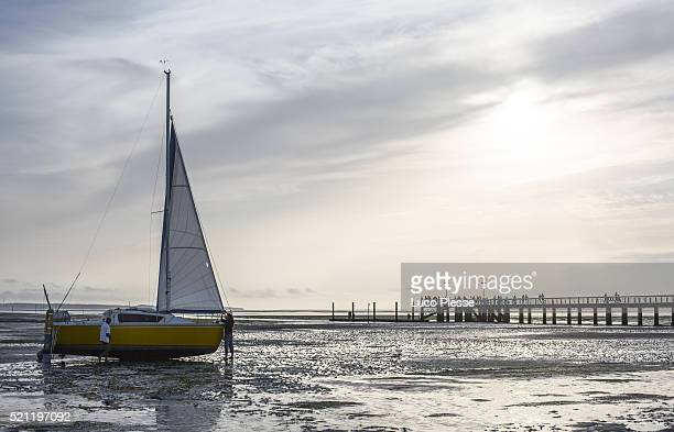 A sailboat during the low tide -  France