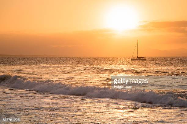 Sailboat in Bay of Alcudia at sunset