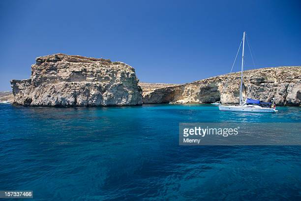 sailboat in blue lagoon - bringing home the bacon stock photos and pictures