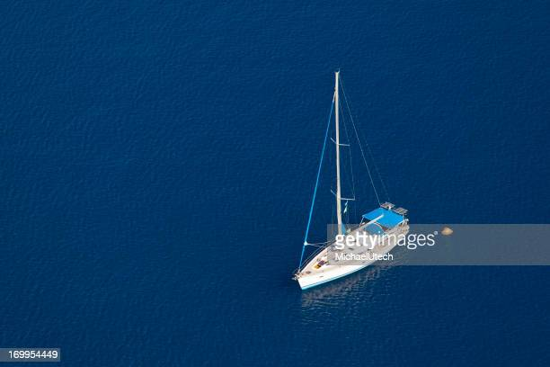 Sailboat In Blue Water
