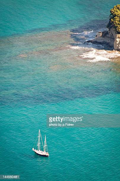 Sailboat in clear mediteranean waters