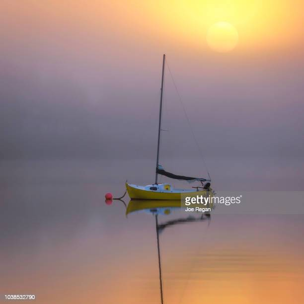 sailboat in fog - moored stock pictures, royalty-free photos & images