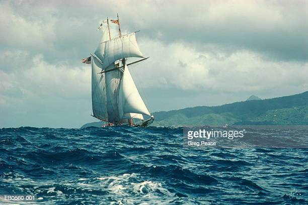 sailboat in rough seas, st. lucia, carribean - pirate ship stock photos and pictures
