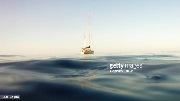 sailboat in the middle of the sea - mid section stock photos and pictures