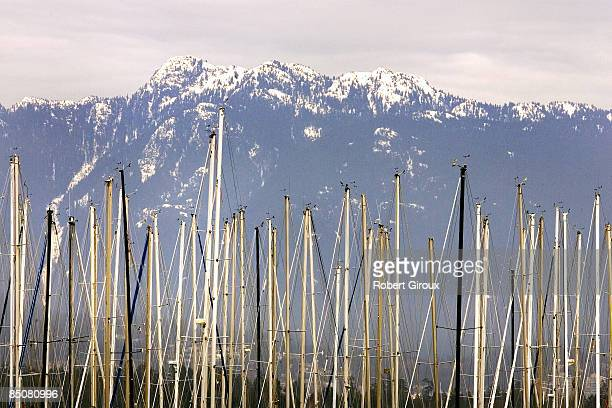 Sailboat masts at the Royal Vancouver Yacht Club line up on English Bay February 17 2009 in Vancouver British Columbia Canada Vancouver is the host...