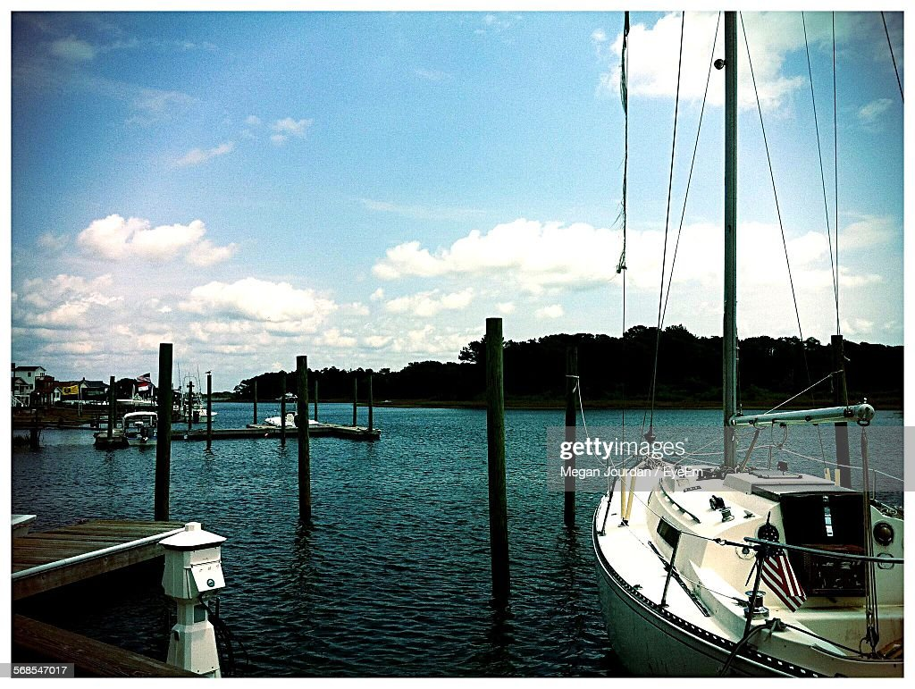 Sailboat Moored On River Against Blue Sky : Stock Photo