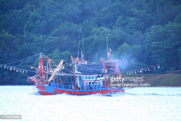 sailboat moored on sea during winter - chanthaburi stock pictures, royalty-free photos & images