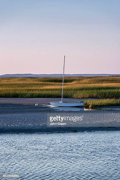 Sailboat moored on tidal flats