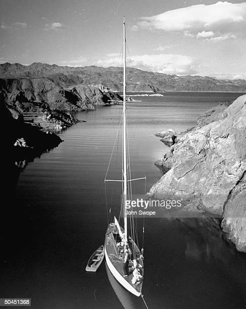 A sailboat moving along Lake Mead