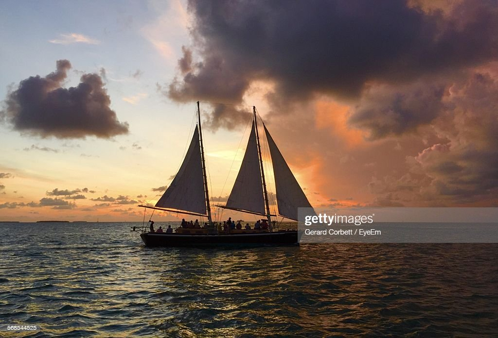 Sailboat Moving On River Against Cloudy Sky : Stock Photo