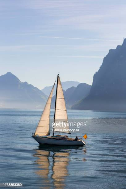 sailboat on a lake lucerne, lucerne, switzerland - sailing stock pictures, royalty-free photos & images