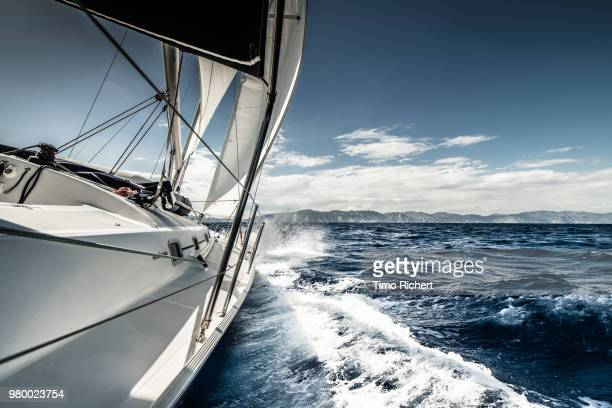 sailboat on aegean sea, greece - images stock pictures, royalty-free photos & images
