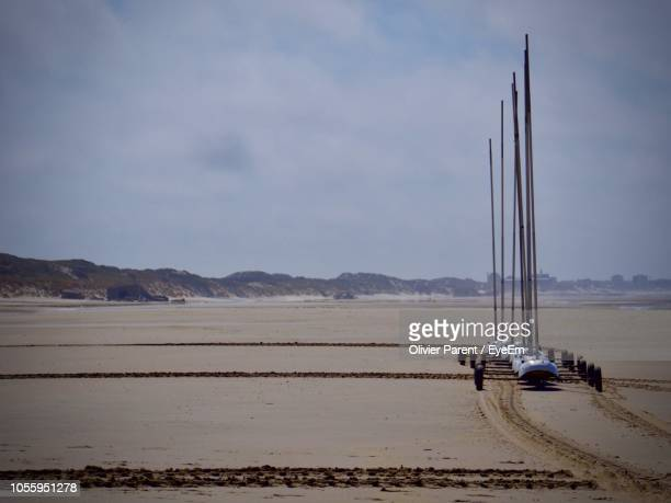 sailboat on beach against sky - le touquet paris plage stock pictures, royalty-free photos & images