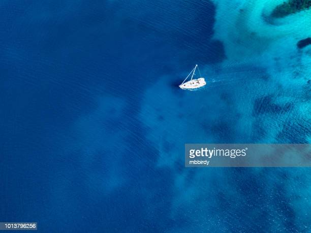 sailboat on cruise, view from drone - sailing ship stock pictures, royalty-free photos & images