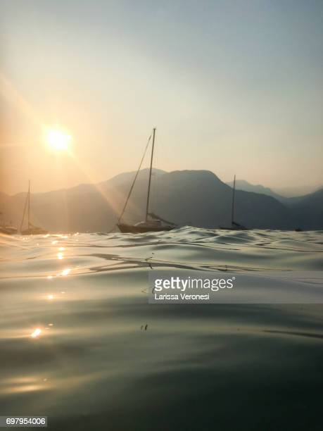 Sailboat on Lake Garda at sunset, Italy