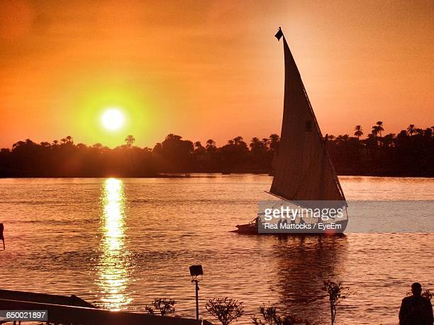 Sailboat On Nile River Against Sky During Sunset