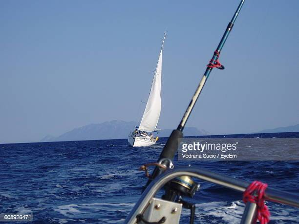 Sailboat On Sea Against Clear Sky