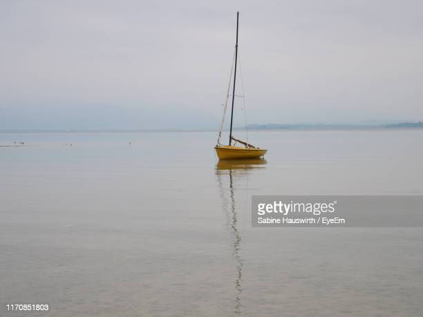 sailboat on sea against sky - sabine hauswirth stock pictures, royalty-free photos & images